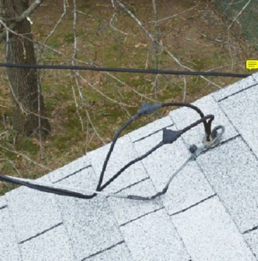 When the power company told its crew to run electricity to this house, I'm sure they didn't mean to just stick all the wires through a hole in the roof!